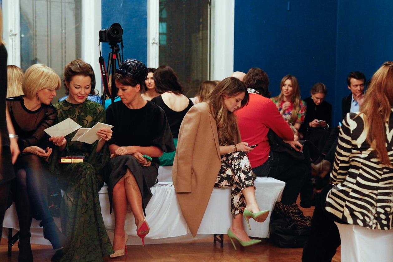 Ulyana Sergeenko looks over invitations and Anastasia Ryabtsova in Celine before Vika Gazinskaya Runway