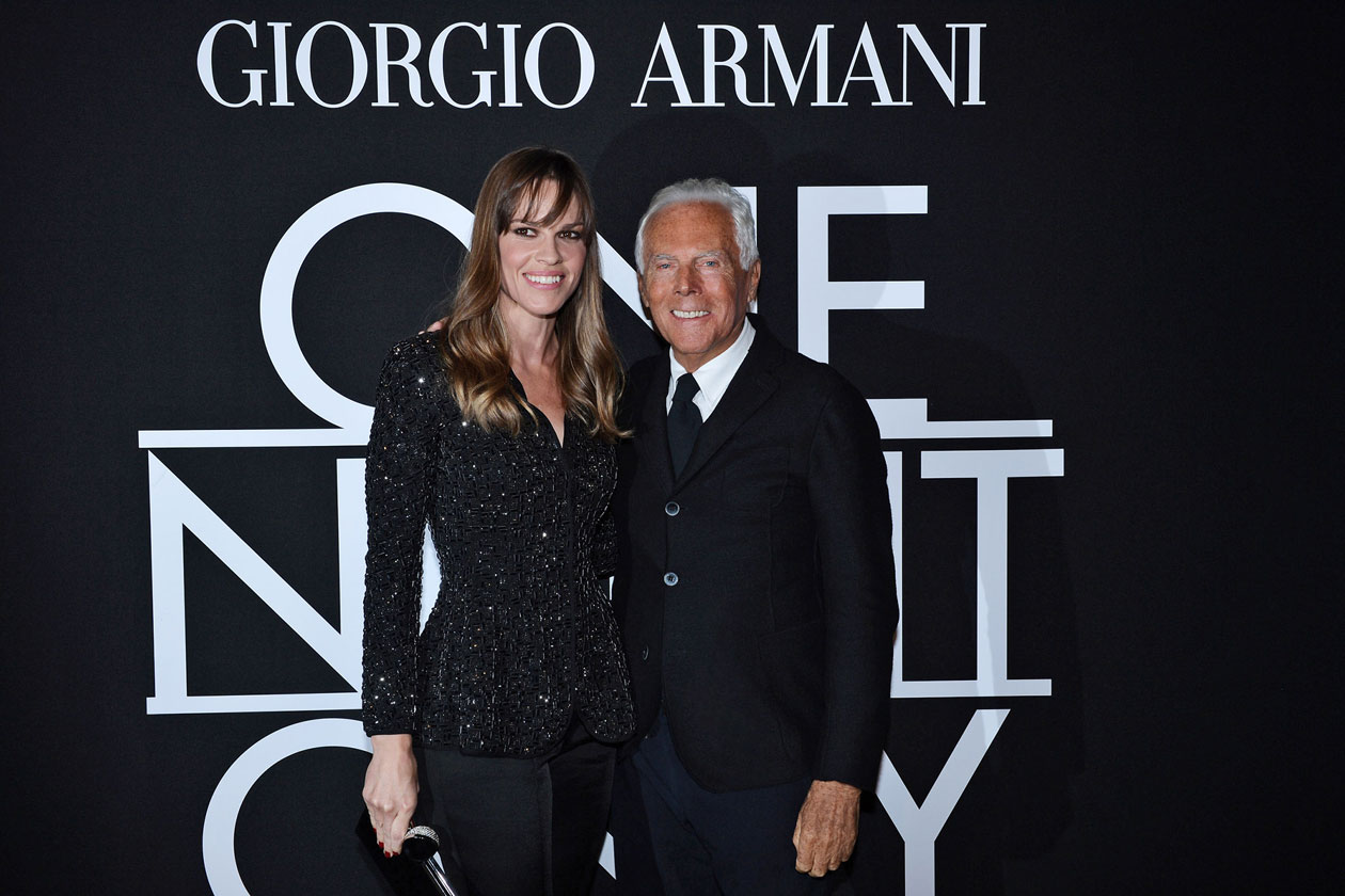Mr. Armani and Hilary Swank