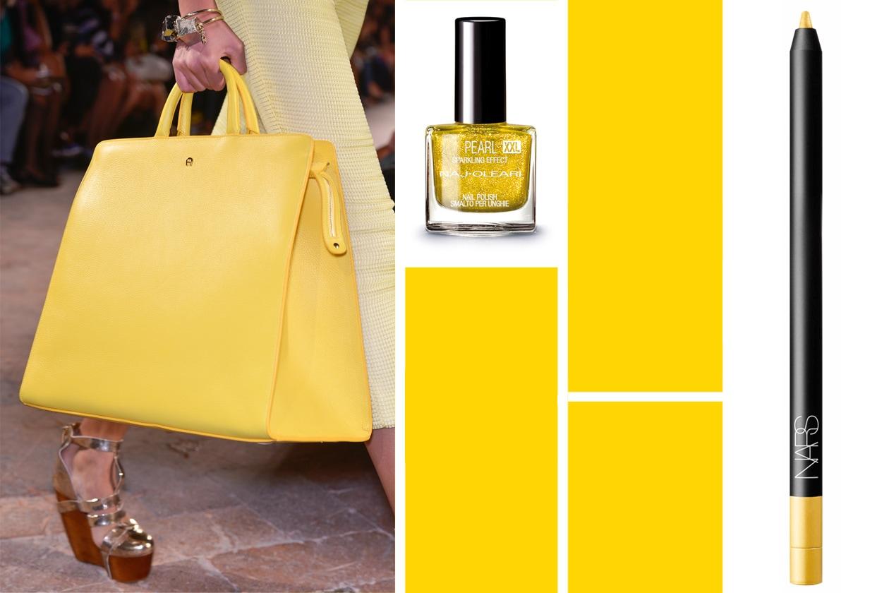 A PORTATA DI MANO…: pennellate di giallo con la maxi bag di Aigner; dello stesso tono il Pearl XXL Lime 116 di Naj Oleari. Eyeliner di NARS
