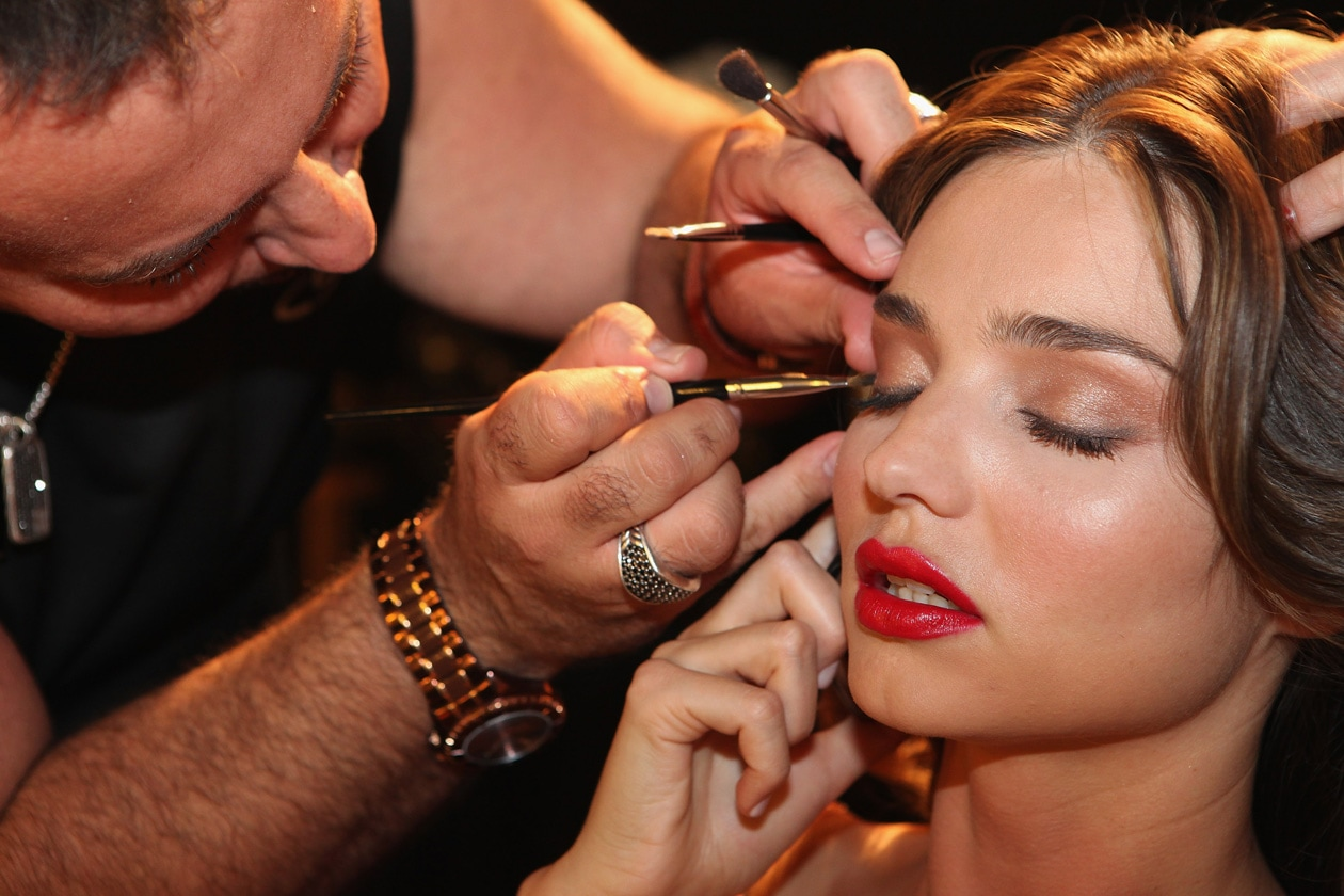 SYDNEY, AUSTRALIA AUGUST 03 In this handout photo provided by David Jones, model Miranda Kerr has her make up applied by Napoleon Perdis