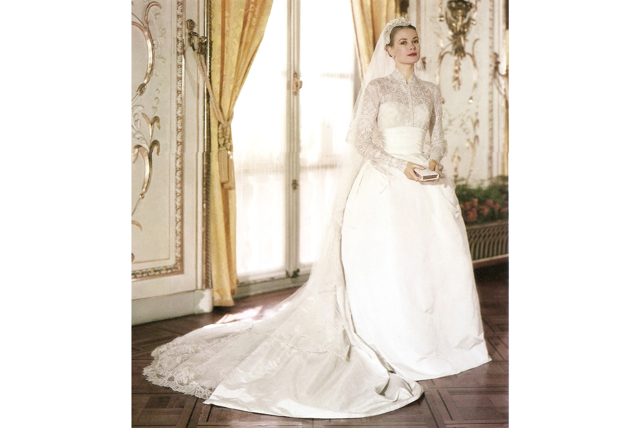 classic charming white satin ball gown with neckline embroidered lace and long sleeves vintage and elegant 1950 grace kellys wedding dress