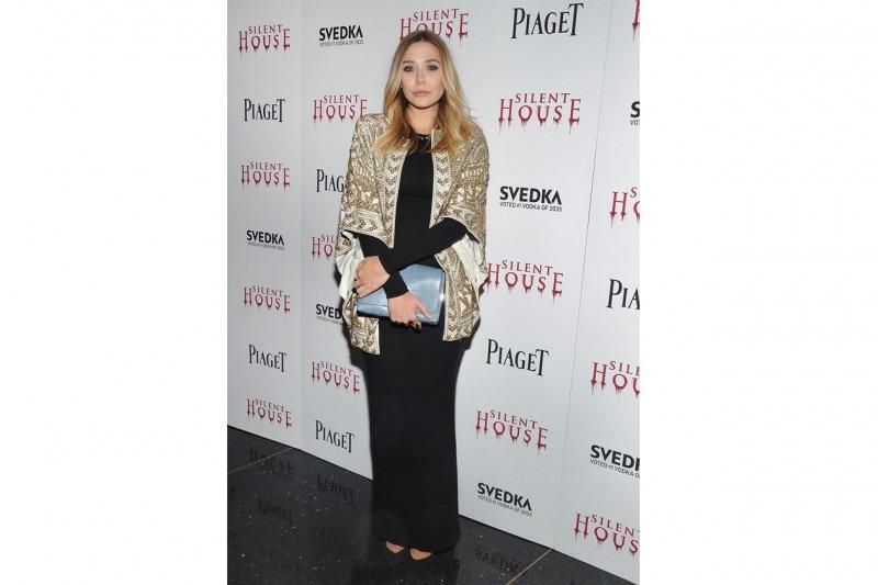 Elizabeth Olsen: in abito e giacca gold
