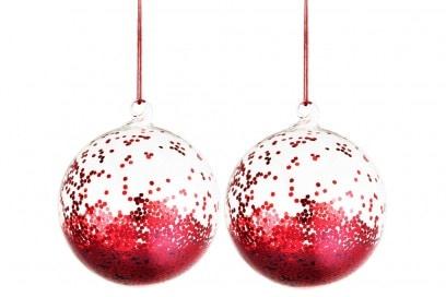 Le palline in vetro piene di glitter rossi
