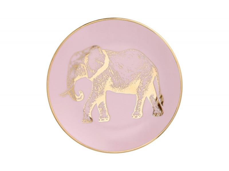 Un elefante oro sul piatto rosa