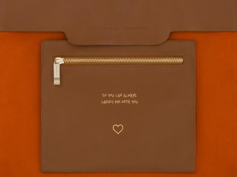 coccinelle-borsa-interno-busta-arancio