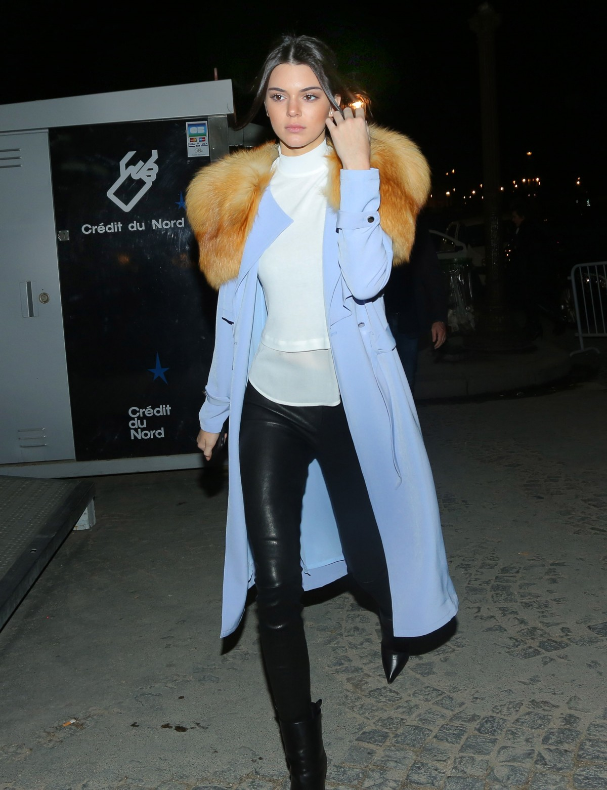 Kendall Jenner shows off her fashion style on a cold night in Paris at the Ferris Wheel