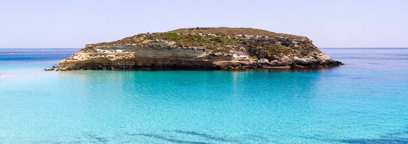 crystalline water surface around an island (Lampedusa)