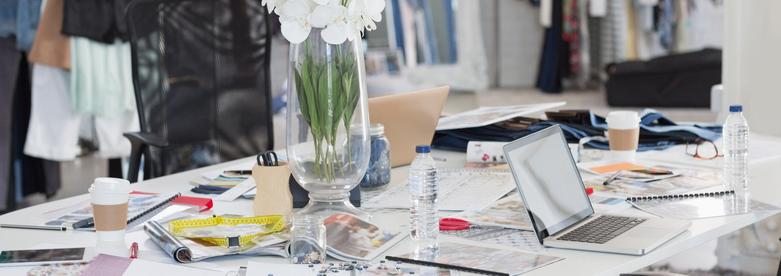 Bouquet, proofs, swatches and clothing in fashion design office. Image shot 2015. Exact date unknown.