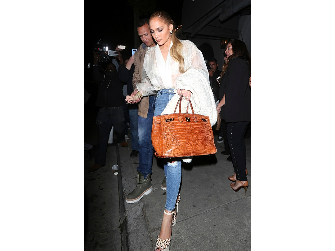Jennifer Lopez holds onto Alex Rodriguez they are spotted leaving Craig's Restaurant after having dinner