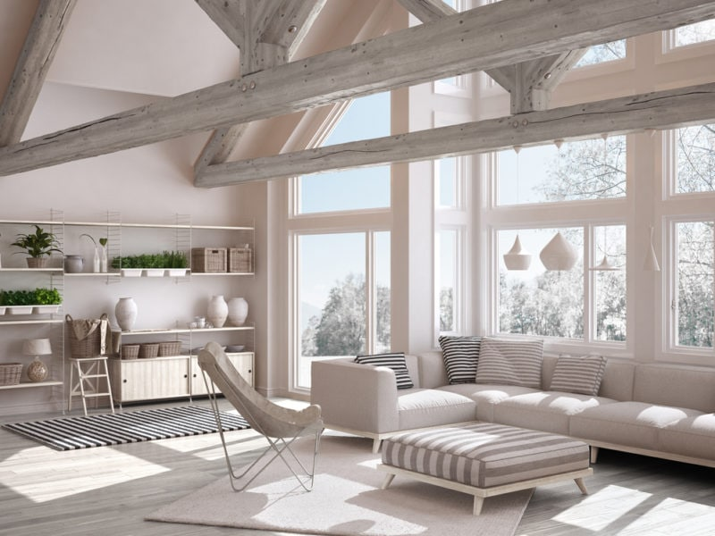 Living room of luxury eco house, parquet floor and wooden roof trusses, panoramic window on winter meadow, modern white interior design