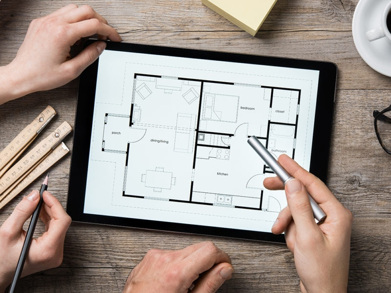 Architect working on digital tablet