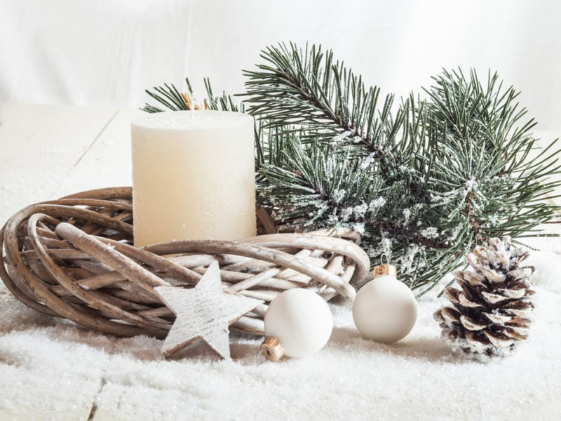 Christmas decoration, candle, artificial snow, twigs, cone, baub