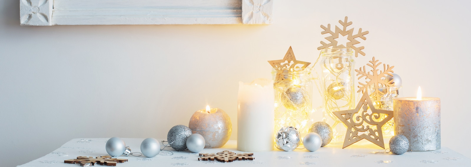 Christmas decoration with candles on background  white wall