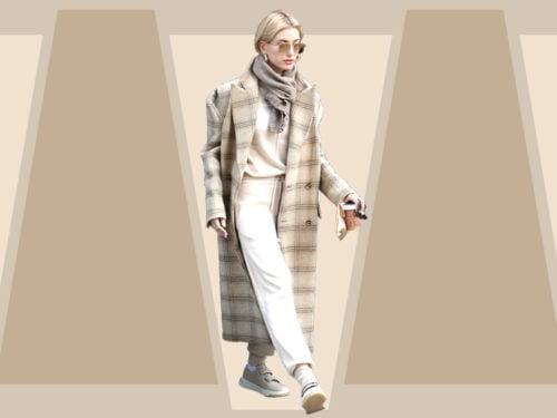 new products b4dd0 497fe Hailey Baldwin: il look in beige con cappotto check e tuta ...