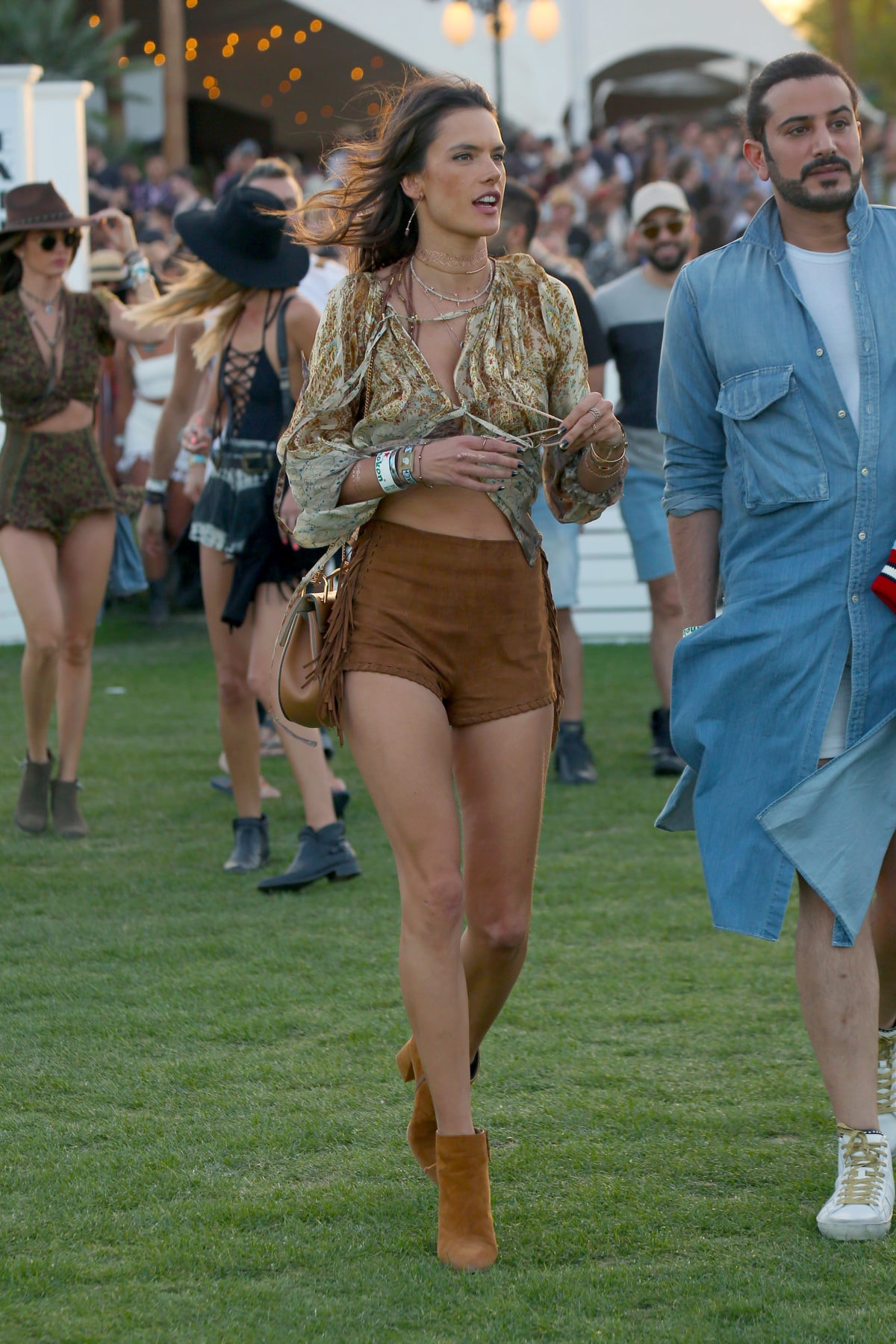Alessandra Ambrosia displays her long legs at Coachella