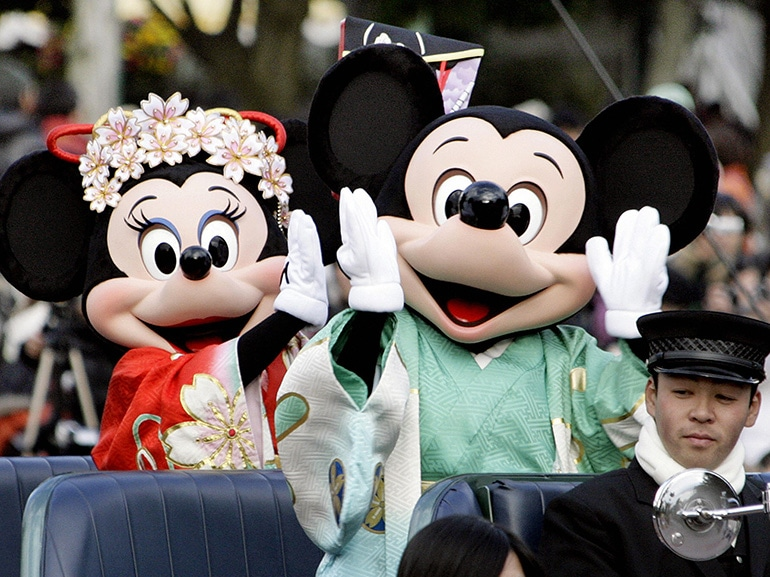 Disney characters Mickey (C) and Minnie
