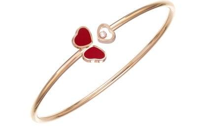 CHOPARD bracciale in oro rosa con diamente e pietra rossa della collezione Happy Hearts Wings CHOPARD