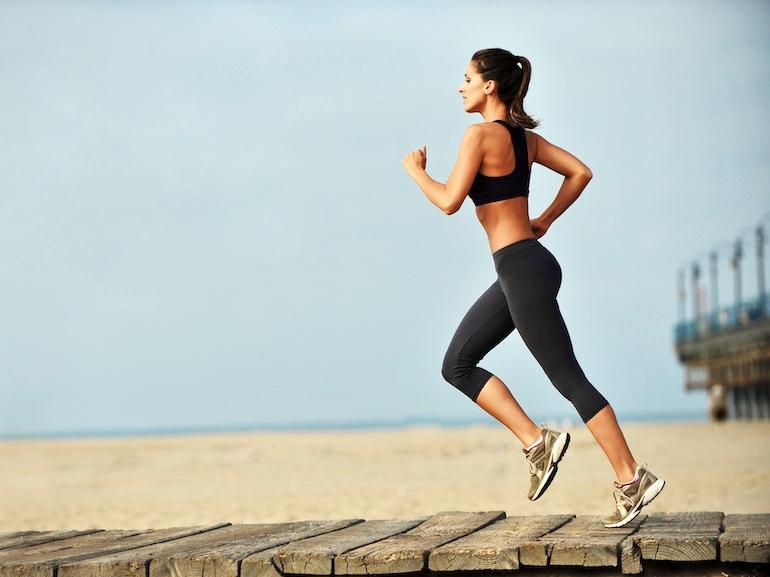 Young Woman Jogging on Boardwalk Santa Monica Beach